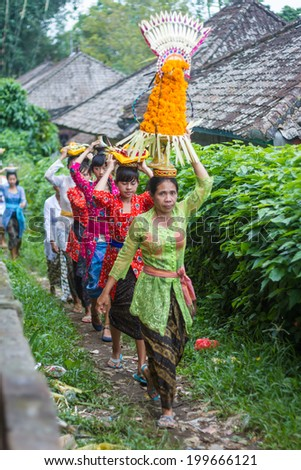 UBUD, BALI, INDONESIA - JUNE 25: Unidentified local people wearing in traditional indonesian clothes take part in traditional Balinese ceremony on June 25, 2013 in Ubud, Indonesia - stock photo