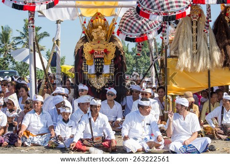 UBUD, BALI, INDONESIA - MARCH 19, 2015 : Unidentified Indonesian people celebrate Balinese New Year and the arrival of spring. People praying at Ketewel beach during the religious ceremony - stock photo