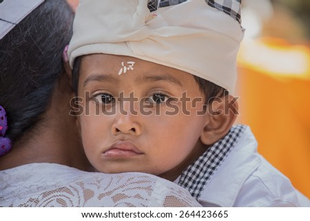 UBUD, BALI, INDONESIA - MARCH 25, 2015 : Unknown Indonesian young boy during the celebration Balinese New Year - stock photo
