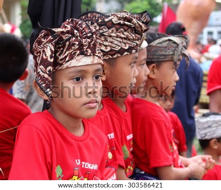 Ubud, Bali, Indonesia, 11 march, 2013, Young boys in traditional costume during the Balinese New Year, also called the Nyepi festival  - stock photo