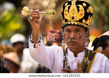 UBUD, BALI, INDONESIA - NOV 1: Balinese priest does prayer rituals for the ceremony of the cremation of the Queen on November 1, 2013 in Ubud, Bali. - stock photo