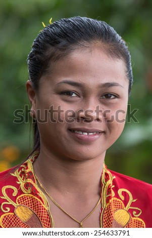 UBUD, INDONESIA - FEBRUARY 18, 2015 : Portrait unknown young Balinese girls in national dress - stock photo