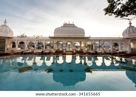 UDAIPUR, INDIA - JANUARY 13, 2015: Taj Lake Palace on January 13, 2015 in Udaipur, India. The Lake Palace was built between 1743 and 1746, it has been voted as the most romantic hotel in the world. - stock photo