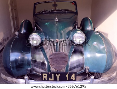 Udaipur, India - September 11, 2015: Vintage Vehicle: Collection within the ground of Garden Hotel, comprises classic vehicles like Cadillac, Chevrolet, Morais etc., belong to the king of Udaipur.