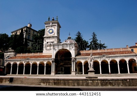Udine, Italy - June 11, 2006: Loggia de San Giovanni, a Renaissance portico with 16th century clock tower topped by two Moorish jacks ringing a bell