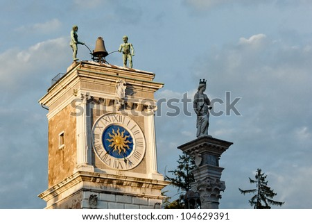 Udine, Italy. The clock tower in piazza Libert� . A 16th century building by Giovanni da Udine. - stock photo
