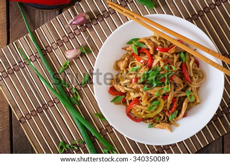Udon noodles with chicken and peppers - Japanese cuisine. Top view - stock photo