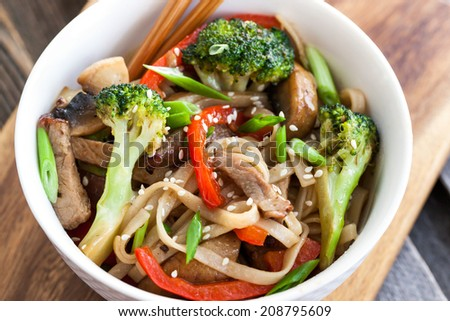 Udon noodles with meat, mushrooms and vegetables - stock photo