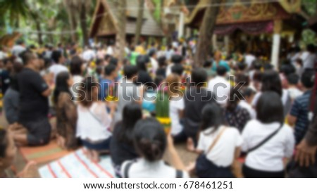 Udon Thani, Thailand - blurred photo of people praying at a temple