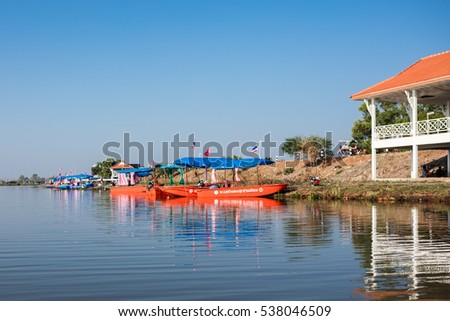 UDON THANI, THAILAND - December 8,2016 : Tourists on boat visiting sea of red lotus water lily festival at Nonghan lake in Bua Daeng.