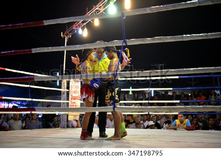 UDONTHANI THAILAND - 4 DECEMBER 2015 : Admission is free unidentified players in Muay thai on December 4 , 2015 at tung sri maung park Udonthani in Thailand - stock photo