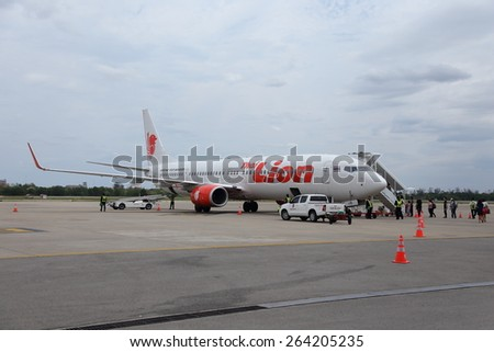 UDONTHANI, THAILAND - MARCH 27 2015: Unidentified group of people walked to Thai Lion Air airplane in Udonthani airport , on March 27, 2015. - stock photo