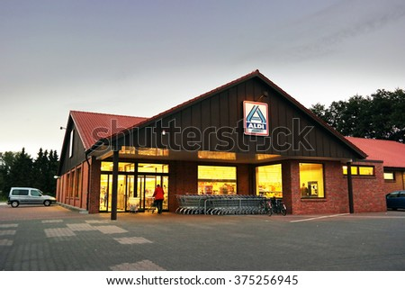 UELSEN, GERMANY - SEPTEMBER 23: Branch of an Aldi discount supermarket, a leading global discount supermarket chain with over 9,000 stores, based in Germany. Taken on September 23, 2015 in Germany - stock photo