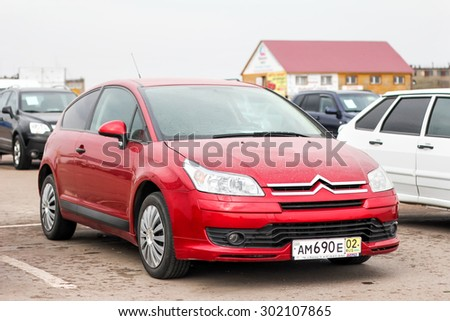 UFA, RUSSIA - APRIL 19, 2012: Motor car Citroen C4 at the used cars trade center. - stock photo