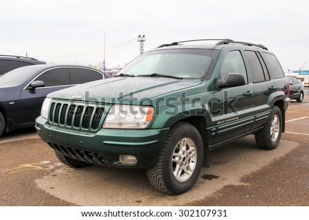 UFA, RUSSIA - APRIL 19, 2012: Motor car Jeep Grand Cherokee at the used cars trade center. - stock photo