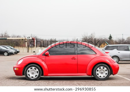 UFA, RUSSIA - APRIL 19, 2012: Red compact car Volkswagen Beetle in the used cars trade center. - stock photo