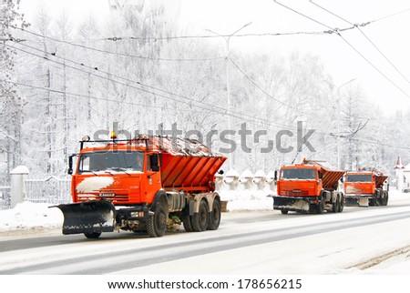 Ufa, russia - january 13, 2010: orange kamaz 65115 road cleaning