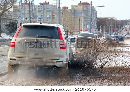 UFA, RUSSIA - MARCH 11, 2015: White crossover Honda CR-V at the city street during a strong flood. - stock photo