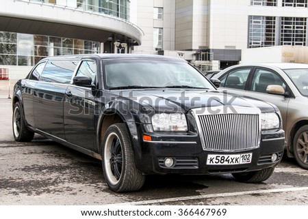 UFA, RUSSIA - SEPTEMBER 27, 2011: Black limousine Chrysler 300C in the city street. - stock photo