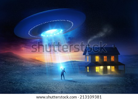 UFO Abduction. A person being abducted in front of his house one spooky evening. - stock photo