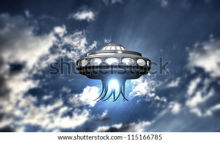ufo spaceship take off in cloudy blue sky - stock photo