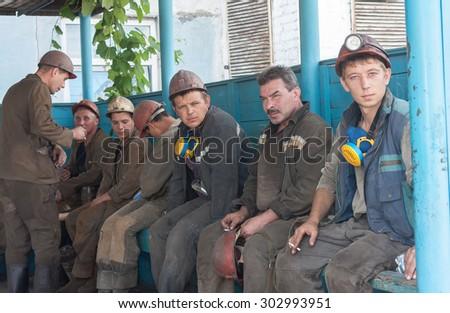 Ugledar; Ukraine - July 17; 2013: Miners Coal Mine South Donbass 1 smoke before going into underground workings - stock photo