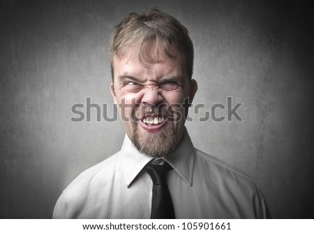 Ugly businessman with embarrassing expression - stock photo