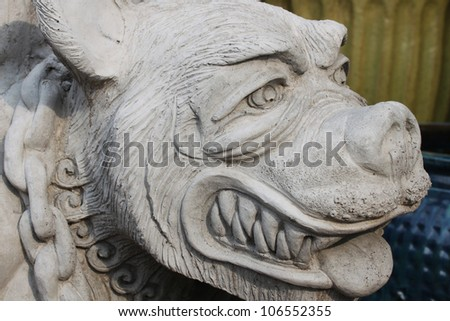 Ugly dog statue closeup - stock photo