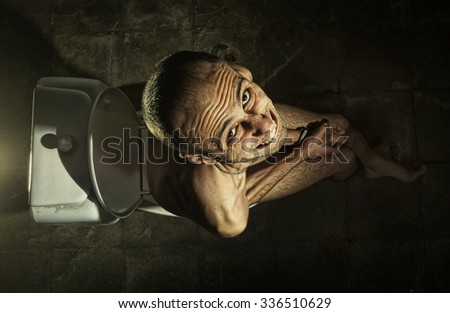 Ugly Man In Toilet - stock photo
