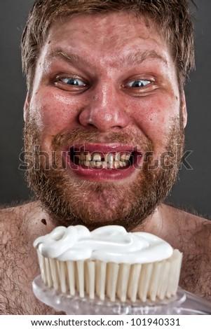 Ugly man preparing to brushing teeth - stock photo