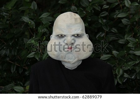 ugly monster ready for halloween and scaring others - stock photo