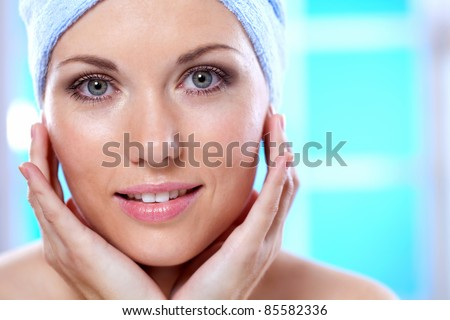 uhazhivet girl in her face - stock photo