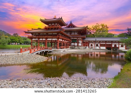 Uji, Kyoto, Japan - famous Byodo-in Buddhist temple with peaple at sunset time - stock photo