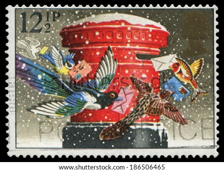 UK-1983: Christmas stamp, birds mailing cards, issued by Great Britain in 1983 for Christmas greeting, canceled in usage. - stock photo