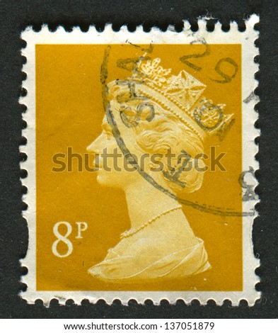 UK-CIRCA 2000:A stamp printed in UK shows image of Elizabeth II is the constitutional monarch of 16 sovereign states known as the Commonwealth realms, in yellow, circa 2000. - stock photo