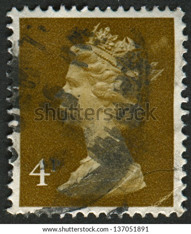 UK-CIRCA 1971:A stamp printed in UK shows image of Elizabeth II is the constitutional monarch of 16 sovereign states known as the Commonwealth realms, in brown, circa 1971.