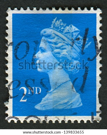 UK-CIRCA 1989:A stamp printed in UK shows image of Elizabeth II is the constitutional monarch of 16 sovereign states known as the Commonwealth realms, in blue, circa 1989.
