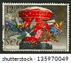 "UK - CIRCA 1983: A stamp printed in UK shows image of The ""Christmas Post"" (pillar-box), circa 1983. - stock photo"