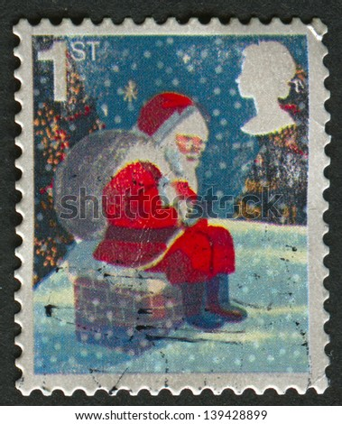 UK - CIRCA 2006: A stamp printed in UK shows image of the Father Christmas on Chimney, circa 2006. - stock photo