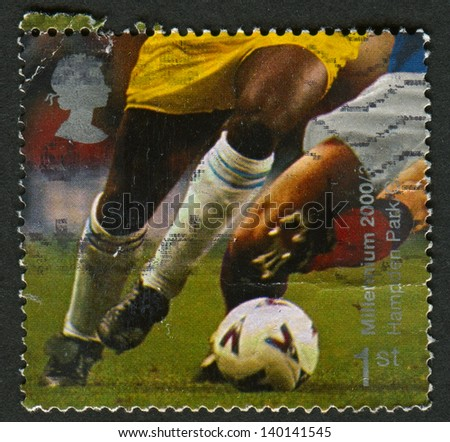 UK - CIRCA 2000: A stamp printed in UK shows image of the Football Players (Hampden Park, Glasgow), circa 2000. - stock photo
