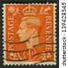 UK - CIRCA 1950: A stamp printed in UK shows image of the George VI (Albert Frederick Arthur George) was King of the United Kingdom and the Dominions of the British Commonwealth, circa 1950. - stock photo