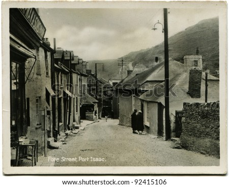 UK - CIRCA 1948: Reproduction of antique postcard shows Fore Street, Port Isaac, Cornwall, England, circa 1948