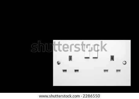 uk double electric soket on pure black background with copyspace - stock photo