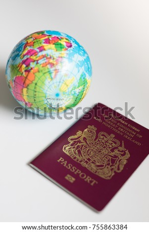 Uk eu british passport on white stock photo edit now 755863384 uk eu british passport on white background with round globe map of the world gumiabroncs Image collections
