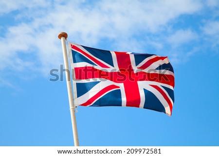 UK flag in the blue sky - stock photo