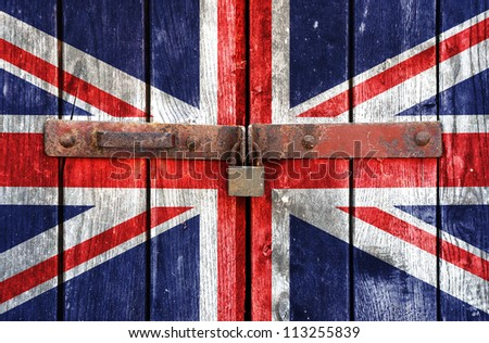 UK flag on the background of old locked doors - stock photo