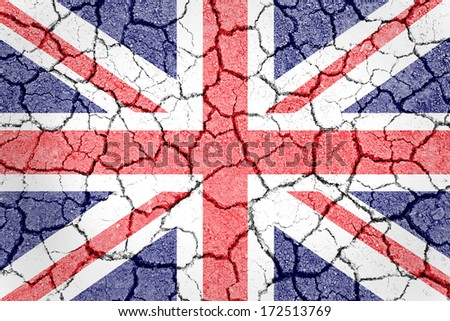 UK flag painted on cracked ground with vignette  - stock photo