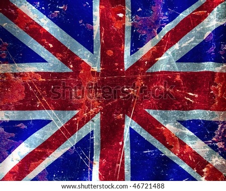 UK flag waving in the wind with some damage - stock photo