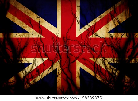UK flag waving in the wind with some spots and stains - stock photo