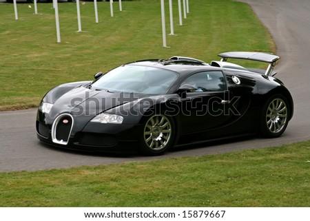 uk goodwood festival of speed â?? 13 july: black bugatti veyron driving on track - stock photo
